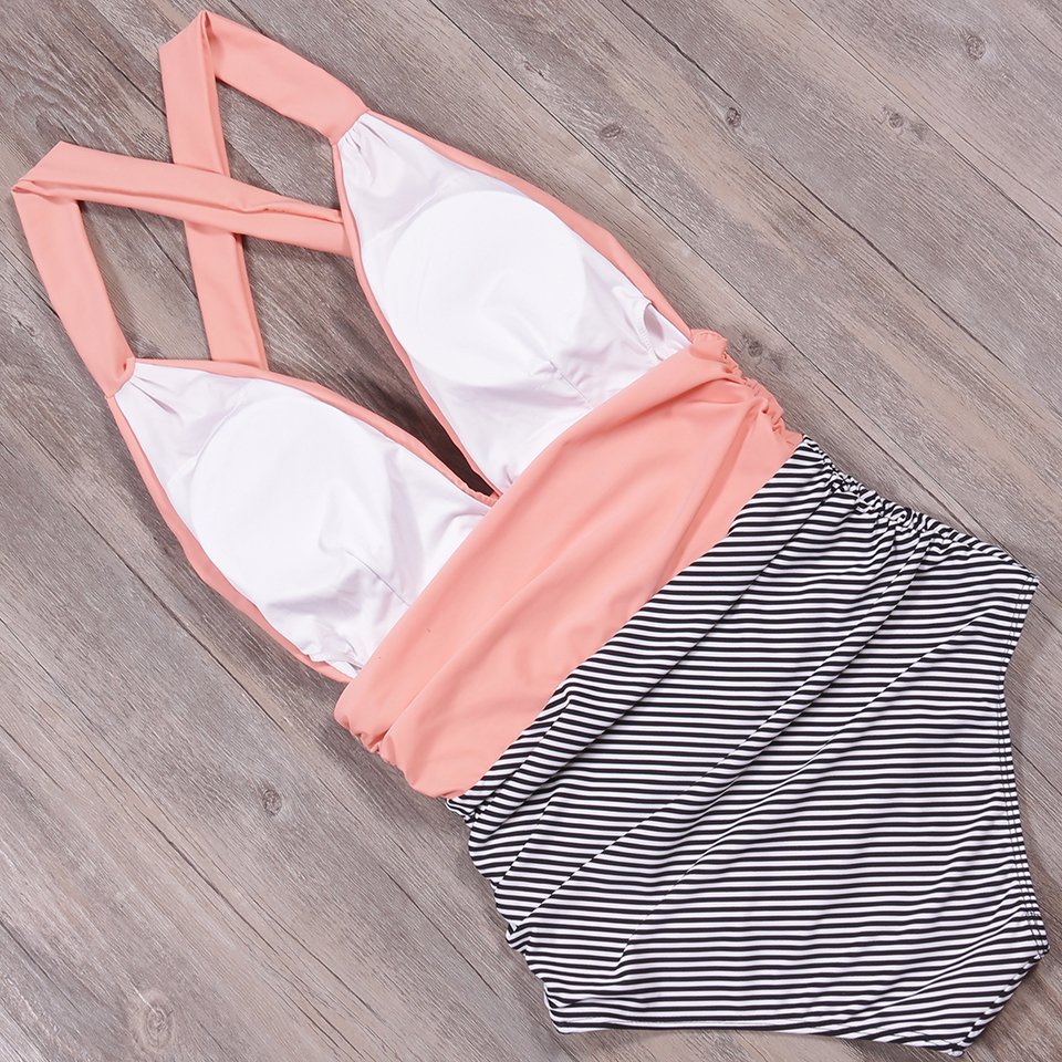 Foto from the back pink color new one piece swimsuit for beach. Swimming backless v-neck for women