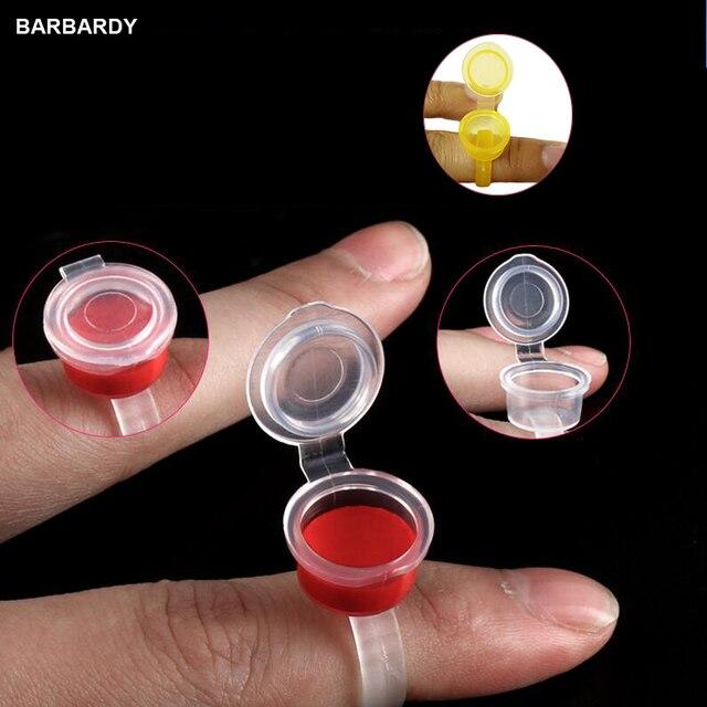 100 piezas tatuaje tinta anillo tazas tapas Microblading pigmento taza titular pegamento taza contenedor de tinta permanente maquillaje pestañas Accesorios