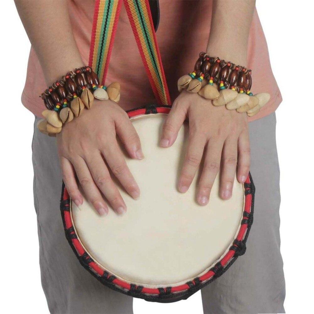 dora nutshell african drum hand bell drum musical instrument bell accessories in tambourine from. Black Bedroom Furniture Sets. Home Design Ideas