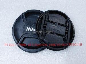 Image 1 - 100 pcs Camera Lens Cap capa 49mm 52 72 67 62 58 55mm mm mm mm mm mm 77mm 82mm LOGO Para Nikon (observe o tamanho)