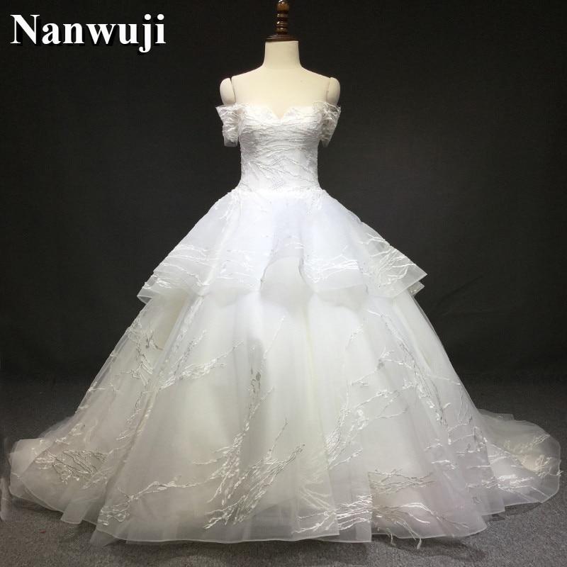 2017 Luxury Lace Wedding Dresses Sweetheart Robe De Mariage Half Sleeves Wedding  Dress Long Train Bridal 604506c7c18a