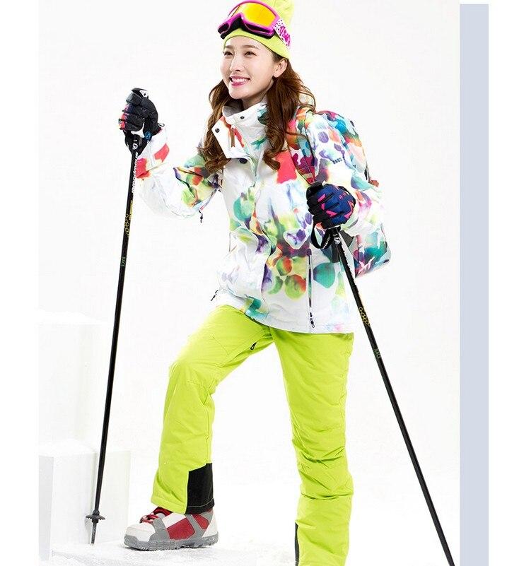 Vêtements de ski pour femmes combinaison de ski d'escalade pour femme veste de ski blanche et pantalon de ski vert jaune avec bretelles