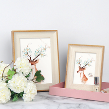Nordic wood photo frame set table cute modern minimalist creative wall hanging Family photo frame picture frame Home decoration a4 size wood photo frame wood card backplane stand table display photo quadro decoration tv wall frame best gift 2019