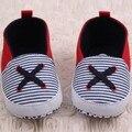 Niño recién nacido lindo bebé de la muchacha del algodón de la lona suela blanda zapatos del pesebre rayas primer caminante