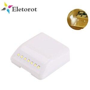 Image 1 - 7 diodo emissor de luz da noite indução pir sensor movimento inteligente noite lâmpada alimentado por bateria gabinete dobradiça luz para armário cozinha gaveta