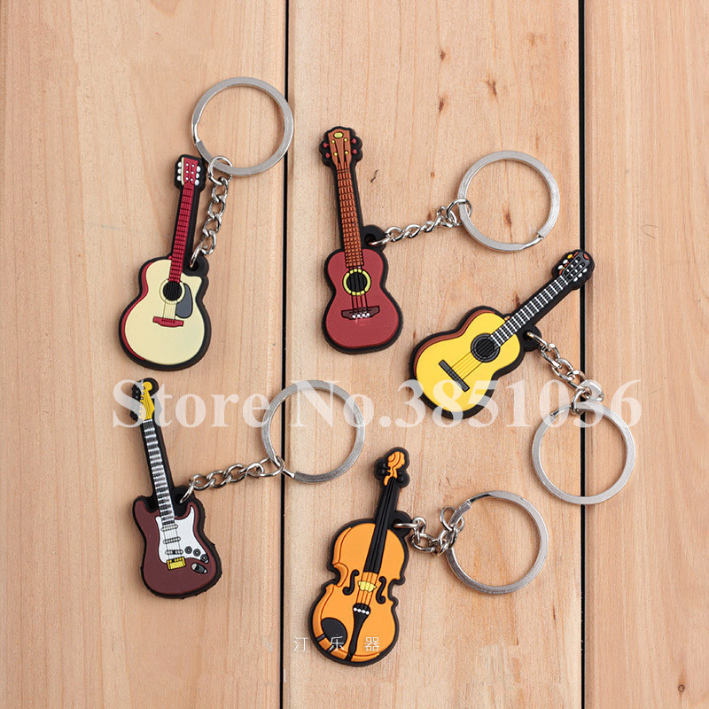100pcs lot Novelty Silicone Electric Classical Guitar Ukulele Shaped Keychains Music Instrument Keyrings for Concert Gifts