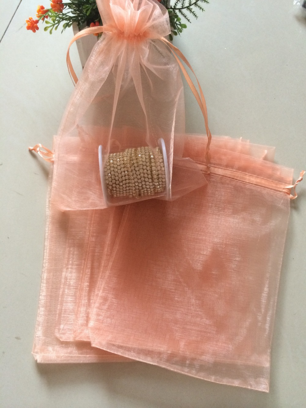 Free Shipping 100pcs Lot Peach Color 17x23cm Christmas Wedding Gift Bags Jewelry Ng Pouches In Party Diy Decorations From Home Garden On