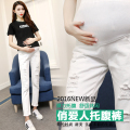 The new 2016 white Maternity Pants Pregnant jeans hole pencil pants Autumn maternity jeans maternity