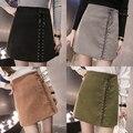 Modelos de outono e inverno meia-passo-cintura alta cashmere camurça pacote de hip saia de moda selvagem Uma palavra curta saia