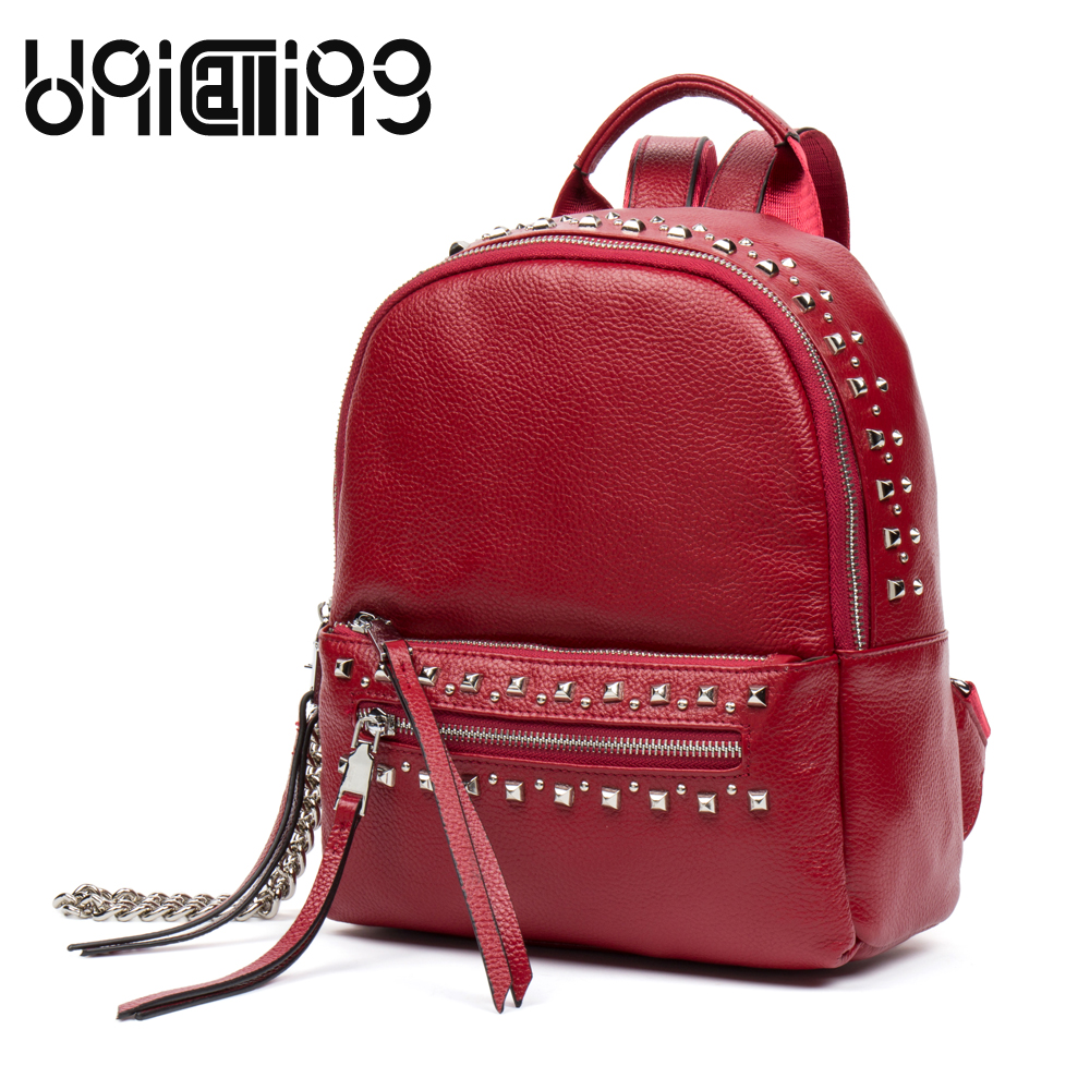 все цены на UniCalling New style cow leather rivet backpack women fashion brand All-match mini backpack solid color Chain Tassel backpack онлайн