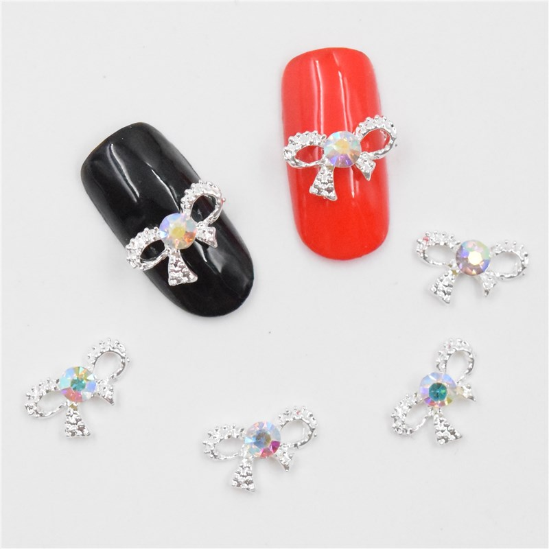 50pcs Manicure Silver bow 3D Nail Art Decoration,Alloy Nail Charms, Nails Glitter Rhinestones Nail Supplies 101 10pcs gold 3d rudder metal flower pearl music note mixed rhinestones cross nail art decoration jewelry nails supplies y180 187
