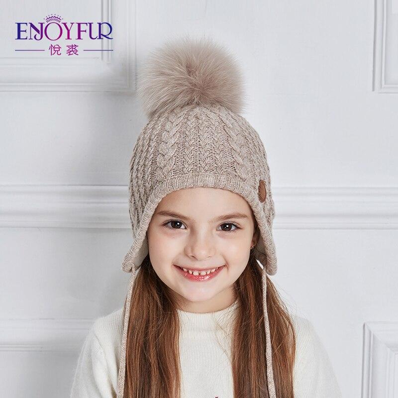 ENJOYFUR niños Caps grueso invierno cálido Caps para bebé Fox Fur Pom buena  calidad caliente edad 2 8 niños Niñas oídos sombrero gorros en Sombreros y  ... 2298fc99aa0
