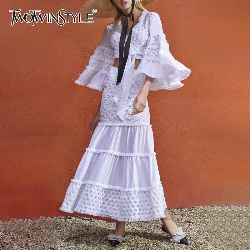 TWOTWINSTYLE Elegant Tassel Patchwork Women Suit V Neck Flare Bandage Crop Tops High Waist Slim Midi Skirt Two Piece Set Female