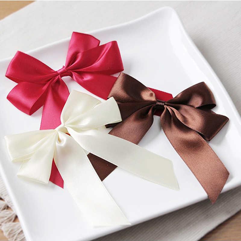 5pcs di Colore Rosso Del Nastro Del Raso del Legame di Arco Vestiti Accessori Regalo FAI DA TE Craft Wedding Decorazione Festa di Compleanno