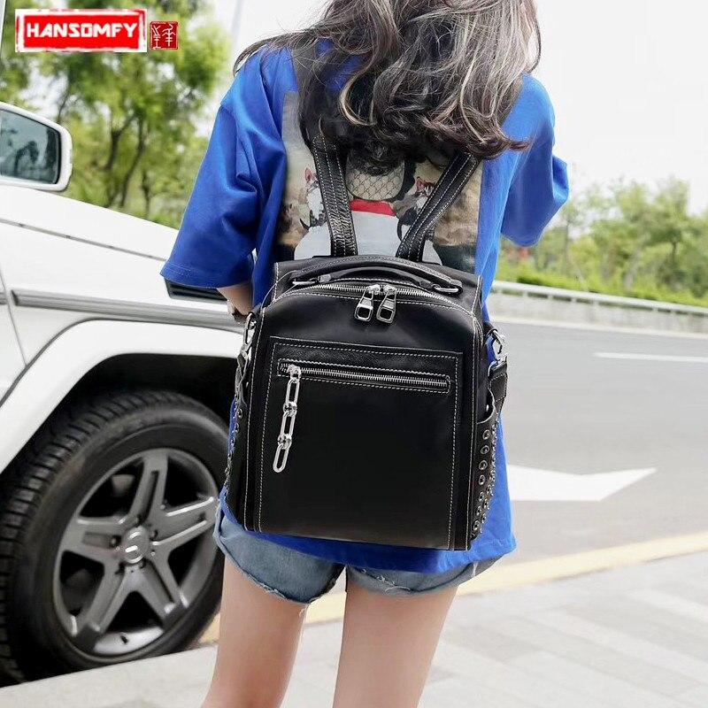 2018 nouveau cuir véritable avec tissu Oxford femmes sacs à dos femme sac à bandoulière mode rivet sac à dos marée noir sac de voyage