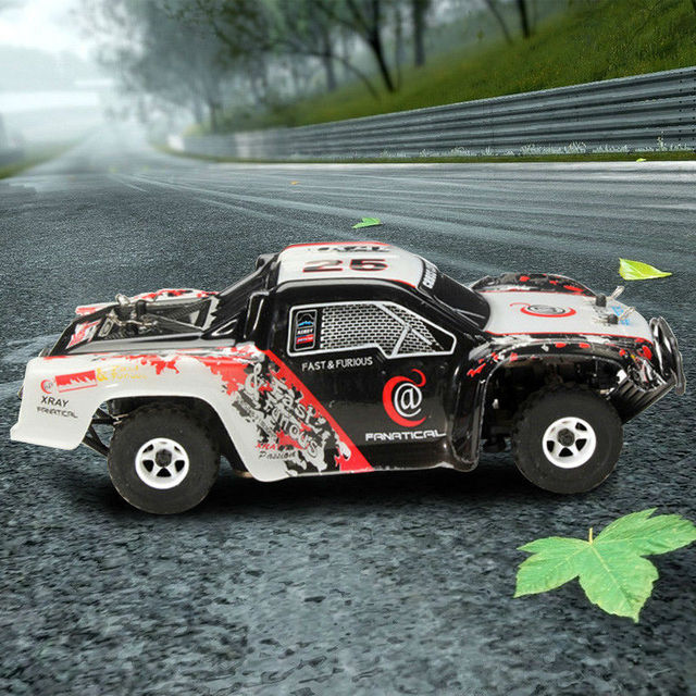 O Envio gratuito de Venda Quente brinquedos do rc carro de corrida wltoys WL Wltoy K999 Super 4WD 2.4 GHz Controle Remoto Deriva Toys1: 28 Alta Velocidade VS A979