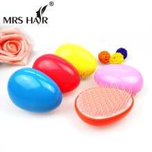 Фотография Mini Tangle Hair Brushes Combs 5 Color Egg Shape ABS Magic Wigs Brushes Comb Magic Detangling Handle Tangle