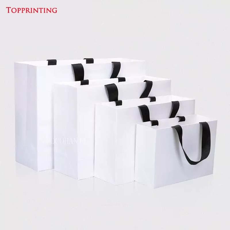 Großhandel 500 teile/los Benutzerdefinierte Luxus Boutique Kleidung Papier einkaufstasche mit logo papier geschenk beutel mit band griff-in Einkaufstaschen aus Gepäck & Taschen bei  Gruppe 1