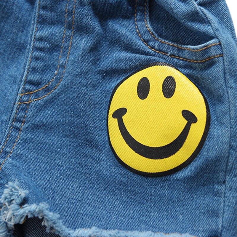 Детские Обувь для девочек и Обувь для мальчиков Шорты для женщин Улыбающееся Уход за кожей лица с Джинсы для женщин карман джинсовые летние ...