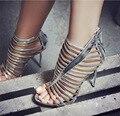 Atractiva de las mujeres Negro Oro Plata zapatos Sandalias Sexy hollow High Heel Gladiador Sandalias Verano de Las Mujeres Zapatos de fiesta