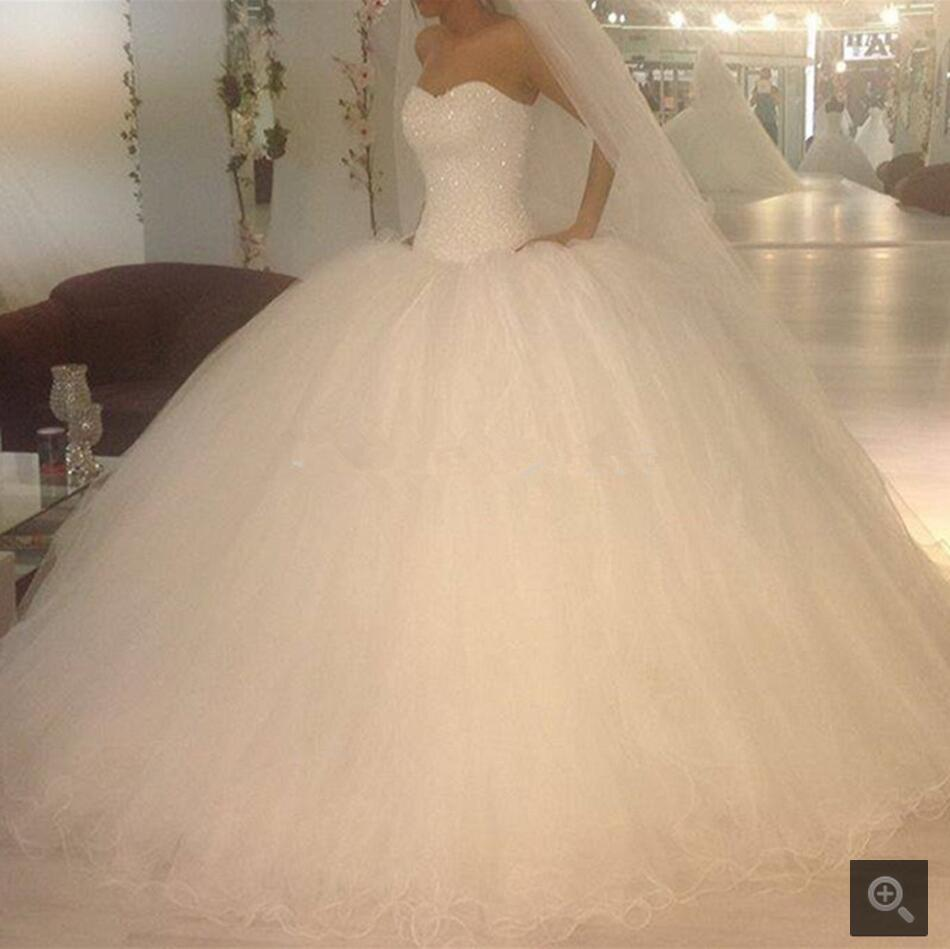 2016 Ball Gown Sweetheart Backless Abito da sposa Perle Puffy Wedding Robe De Mariage Tulle Abiti da sposa Principessa Abito da sposa
