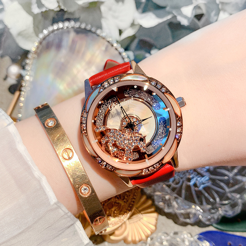 Rotatif pour exécuter la montre style féminin tempérament rotatif boucle tête montre femme simple