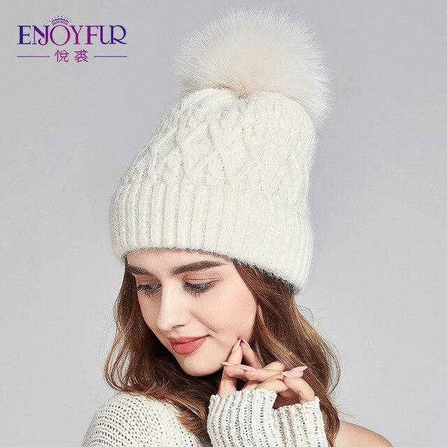 ENJOYFUR Thick Winter Hats For Women Fashion Fur Pompom Caps Imitated Wool  Twist-type Warm Lining beanies 03fd3360de5