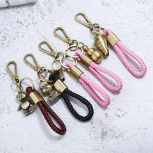 Retro Weave gevlochten lederen touw sleutelhanger & sleutelhanger Vintage bronzen handgemaakte sleutelhanger Creatieve auto sleutelhanger accessoires