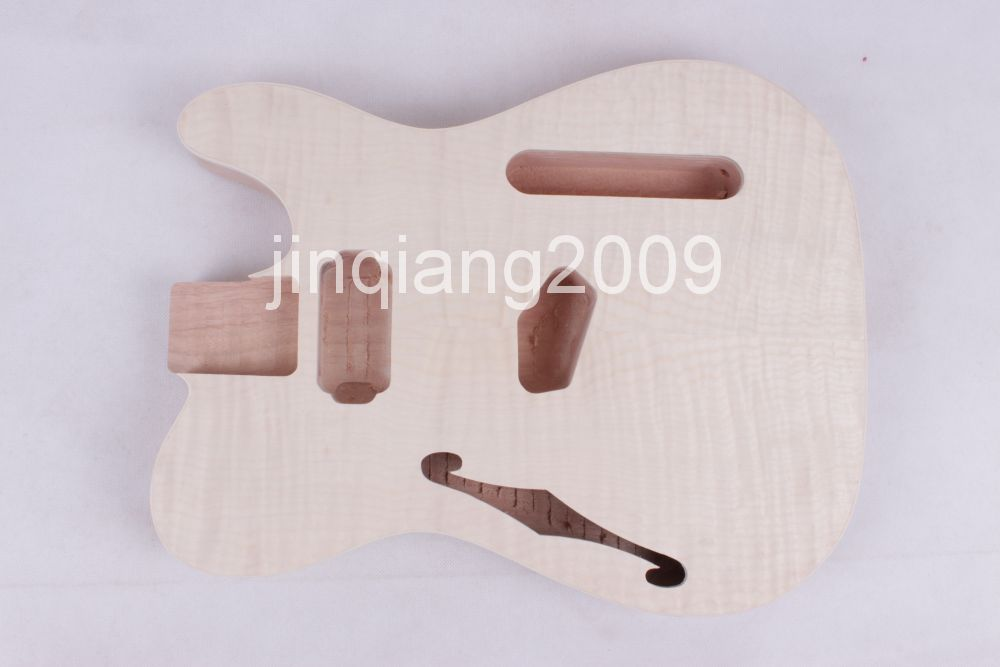 ONE Unfinished electric  guitar body new high quality Mahogany wood made and  flam mple top  one high tech and fashion electric product shell plastic mold