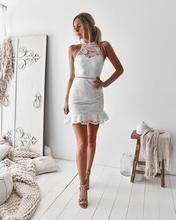 все цены на Sexy lace halter sleeveless ruffle bodycon mini dress transparent elegant summer dress 2019 women white club party wrap dresses
