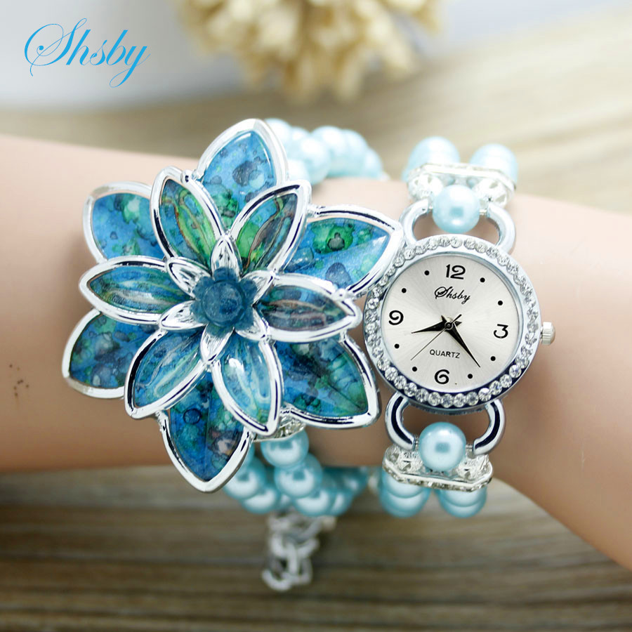 Shsby แฟชั่นผู้หญิง Rhinestone นาฬิกาสุภาพสตรีสายมุกหลายกลีบดอกไม้สร้อยข้อมือควอตซ์นาฬิกาข้อมือผู้หญิงแต่งตัวนาฬิกา