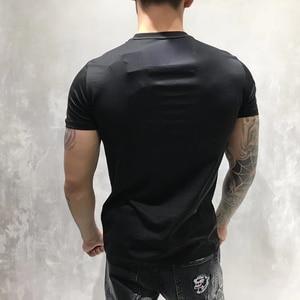 Image 2 - Camiseta de diseño de PP para hombre, camiseta de manga corta de algodón, camisetas de calavera Multicolor con diamantes de imitación para verano