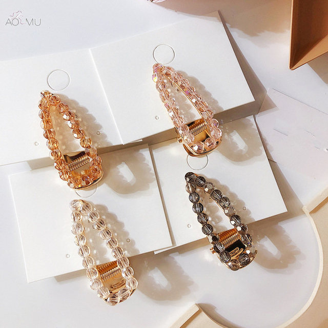 AOMU Корея Мода шампанского Crystal Заколки для волос геометрическая форма капли заколки для Для женщин из металла золотистый цвет волос аксессуары