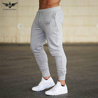 KORKSLORES 2017 Brand Muscle Fitness Mens Long Pants New Casual Cotton Trousers Exercising Bodybuilding Gyms Breathable Pants