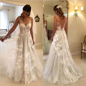 Image 1 - Beach Vestido De Noiva Wedding Dresses A line V neck Tulle Lace Backless Dubai Arabic Boho Wedding Gown Bridal Dresses
