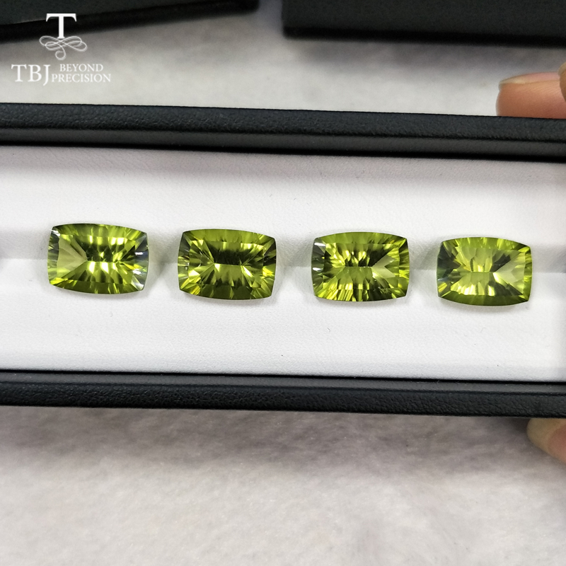все цены на Tbj ,natural olive green topaz cu10*14 concave cut ard 7ct for 925 silver or gold jewelry mounting,natural loose gemstones