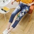Impresión de la historieta para Jeans 2016 nuevo estilo Loose Ripped Denim Jeans pantalones Capris más el tamaño 5XL azul WM02