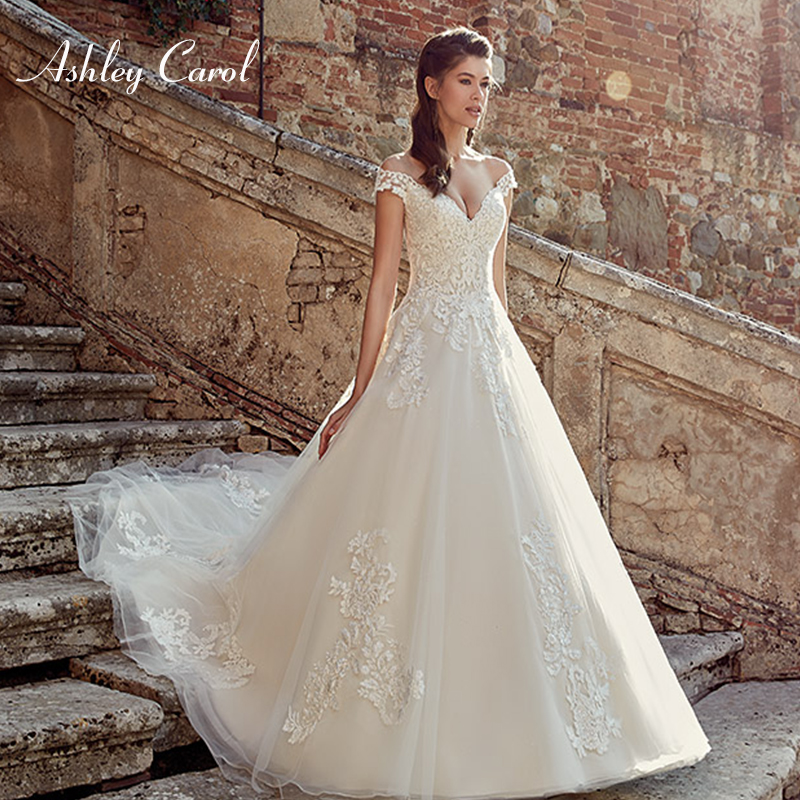 Ashley Carol 2019 A Line Wedding Dresses Sexy Illusion Cap Sleeve Deep V Neck Sleeveless Simple with delicate de Bridal Gown