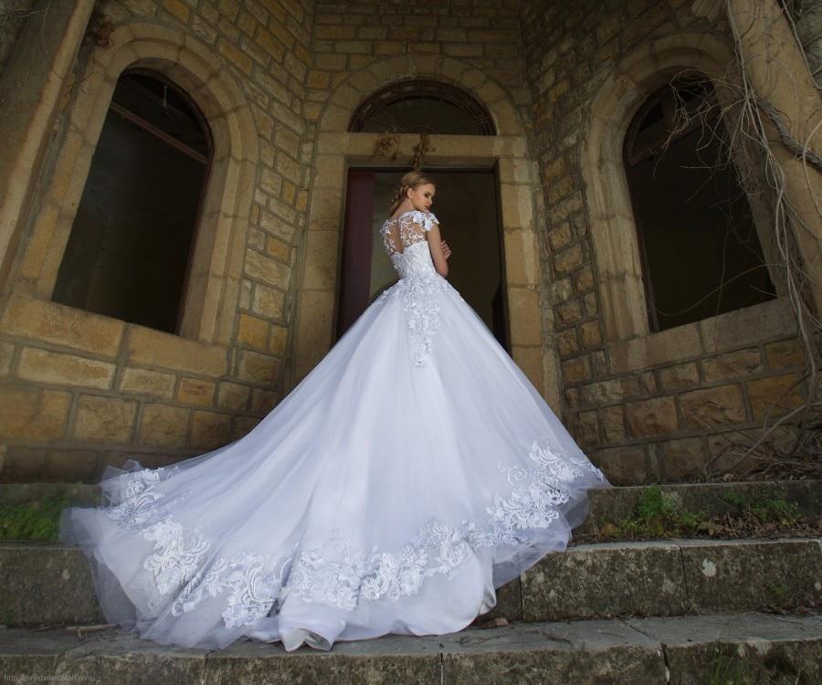 Vestido de noiva Luxury Lace Wedding Dresses Short Sleeve Soft Tulle Puffy  Wedding Dress Long Train Bridal Gowns Casamento-in Wedding Dresses from  Weddings ... f6117fed024e