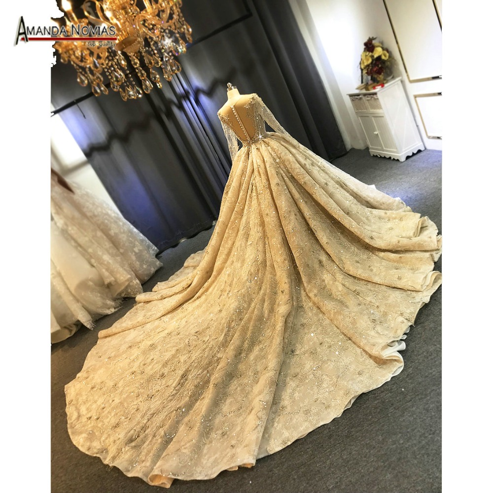 Top quality luxury long train wedding dress champagne color with long sleeves full beading 2019