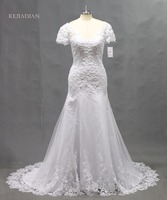 Luxurious A Line 2017 Long Wedding Dress Sleeveless O Neck Sheer Tulle Lace Appliques Chapel Train