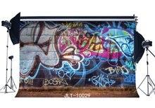 Zdjęcia tła w stylu Graffiti tętniącej życiem artystyczne ceglany mur tło