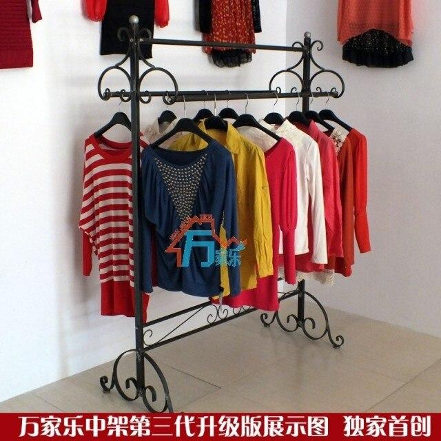 Tienda de ropa escaparate de suelo doble varilla perchero percha en ...