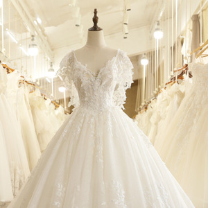 Image 4 - SL 7805 осень Пышный рукав с открытой спиной кружевной аппликацией Иллюзия лиф v образным вырезом Свадебное платье 2017