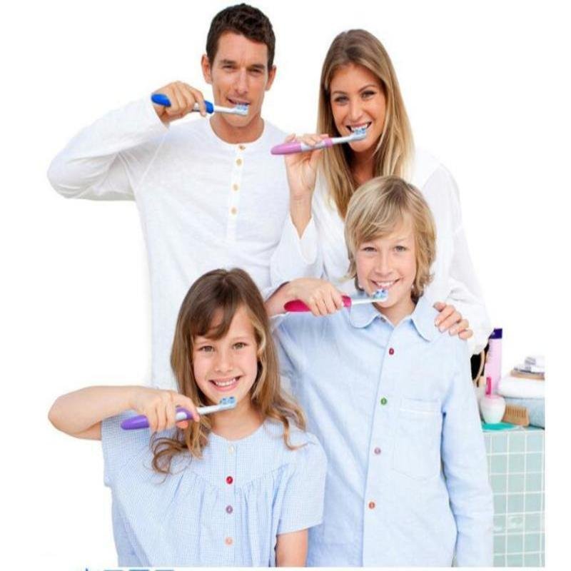 Electric toothbrush with 2 pcs toothbrush heads + 4734 Cross bristled electric toothbrush head