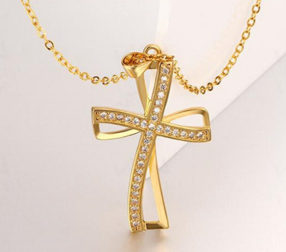 yellow crucifix gold made pendant in
