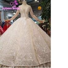Luxury Wedding Dress 2019 Sheer Neck Long Sleeve Lace Appliques Bridal Gown  Peplum Ball Gown Glitter Bride Dress Vestidos Custom f722e645450c