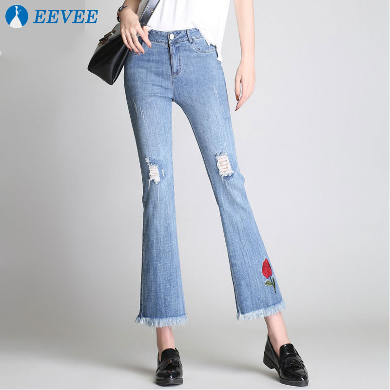 2018 New spring women's jeans, high quality Hole Washed jeans slim rose Embroidered rose jeans.