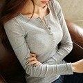 2015 mujeres del invierno coreano de manga larga T-shirt botón del cuello delgado pecho abierto con cachemir engrosado basa la camisa marea