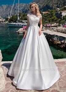 Image 2 - אלילית סאטן O צוואר אונליין חתונת שמלות עם חרוזים תחרת אפליקציות ללא משענת לטאטא רכבת כלה שמלת vestido דה novia